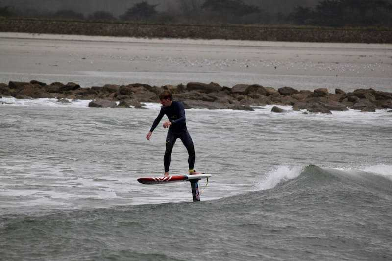 individual in action in surf foil