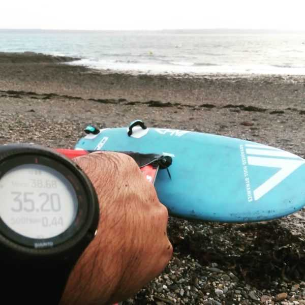 individual showing his speed on watch with ahd SL3 in the background