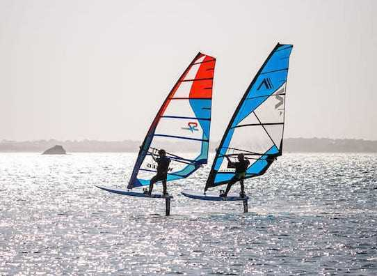 2 individuals in foil windsurfing action